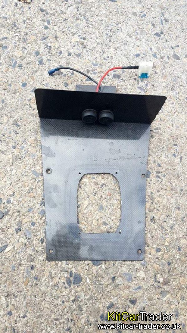Carbon fibre tunnel gear gaitor surround with 12v supplies